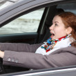 Pretty young Caucasian woman stopping the car and screaming  Looking forward — Stock Photo
