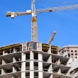 Buildings under construction with cranes on blue sky — Stock Photo #10949889