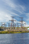 Electric power transmission on hydroelectric station on blue sky — Stock Photo