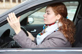 Pretty young Caucasian woman carefully driving a car — Foto de Stock