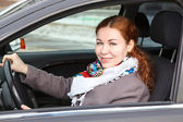Pretty young Caucasian woman driving a car — Stock Photo
