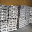 Stack of raw aluminum ingots in aluminium factory — Stock Photo