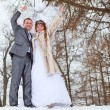 Stock Photo: Young wedding Caucasian Russian couple walking on snowy park. Winter season in Russia