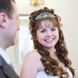 Beautiful newly merried bride and bridegroom looking at each other — Stock Photo