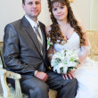 Beautiful newly merried man and woman sitting together — Stock Photo