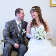 Beautiful newly merried man and woman sitting and looking at each other — Stock Photo #10950133