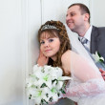 Young wedding Caucasian Russian couple hearing near closed doors — Stock Photo #10950138