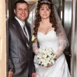Young wedding Caucasian Russian couple standing in opened doors lift — Stock Photo #10950177