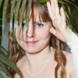 Woman in crown under palm leaf — Stock Photo