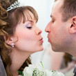 Young wedding Caucasian Russian couple kissing together and flowers between — Stock Photo #10950204