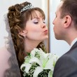 Young wedding Caucasian Russian couple kissing together and flowers between — Stock Photo #10950210