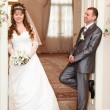 Happy Caucasian newlywed couple in wedding office — Stock Photo