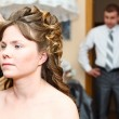 Bride's make-up before wedding and waiting and worried groom — Stock Photo