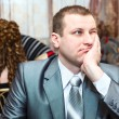 Stock Photo: Tired CaucasiRussibridegroom waiting for bride during wedding preparations in domestic room