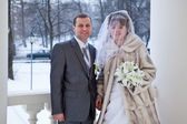 Beautiful nealy merried couple standing on stairs in winter — Stock Photo