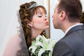 Young wedding Caucasian Russian couple kissing together and flowers between — Stock Photo