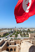 National flag of Tunisia against the city — Stock Photo