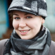 Happy smiling woman close up portrait in cap and scarf — Stock Photo #11347483