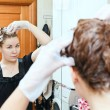 Portrait of pretty Caucasian beautiful woman dyeing hairs at domestic bathroom — Stock Photo