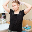 Portrait of pretty Caucasian beautiful woman dyeing hairs at domestic bathroom — Stock Photo #11347490
