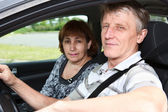 Senior Caucasian male and woman sitting in land vehicle together — Stock Photo