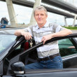 Happy mature driver near the land vehicle — Stock Photo