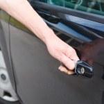 Caucasian man hand holding car door — Stock Photo