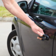 Stock Photo: Caucasimopening car door in black car