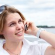 Attractive woman in white shirt with sunglasses calling on mobile telephone. Close up — Stock Photo #12200074