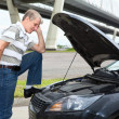 Confused mature driver standing front of car with opened engine compartment hood — Stock Photo