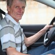 Mature experienced driver a Caucasian male sitting inside of his car — Stock Photo #12200090