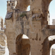 Demolished ancient walls and arches of ruins in Tunisian Amphitheatre in El Djem, Tunisia — Stock Photo #12200099