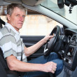 Experienced driver mature Caucasian man sitting inside of own car — Stock Photo #12200103