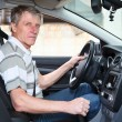 Experienced driver mature Caucasian man sitting inside of own car — Stock Photo