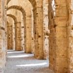 Ancient arches of ruins in Tunisian Amphitheatre in El Djem, Tunisia — Stock Photo #12200107