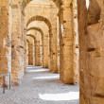 Ancient arches of ruins in Tunisian Amphitheatre in El Djem, Tunisia — Stock Photo #12200112