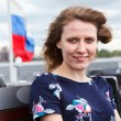 Portrait of young woman in dress with Russian flag on background — Stock Photo