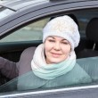 Стоковое фото: Young womlooking from window in car