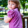 Sweet little girl portrait with looking from back — Stock Photo