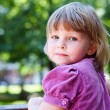 Sweet little girl portrait with looking from back. Copyspace — Stock Photo