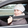 Fastened young woman sitting in car — Stock Photo #12200238