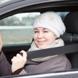 Woman sitting in car with seat belt — Stock Photo