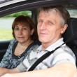 Close up of senior Caucasian couple sitting in domestic car and smiling — Stock Photo #12200282