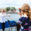 Woman photographer photographing her girlfriend with hand-held camera — Stock Photo