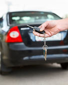 Car alarm systems remote control in hand — Stock Photo