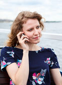 Young one Caucasian woman calling on mobile phone — Stock Photo