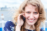 Close up of beautiful Caucasian woman with mobile phone. Copyspace — Stock Photo
