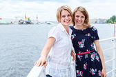 Two ladies on ship deck together with copyspace — Stock Photo
