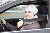 Fastened young woman sitting in car — Foto Stock