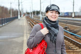 Young Caucasian female standing on railway platform — Stock Photo